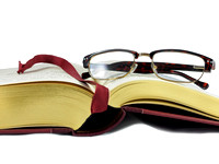 Open book and eyeglasses